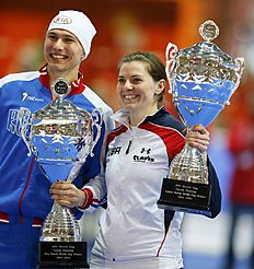 Павел Кулижников and Richardson of the U.S. pose with their throphies as best overall athletes during a ceremony at ISU World Cup Speed Skating Final...