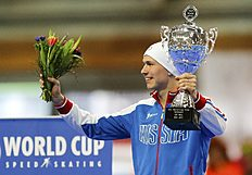 Russia's Kulizhnikov overall winner of the men's 500m speed skating ISU World Cup Speed Skating Final poses with his trophy in Erfurt