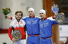Canada's second placed Dubreuil, Russia's winner Kulizhnikov and his team mate third placed Murashov pose on the podium with their trophies after the men's...