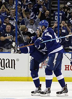 ������ � ������: Tampa Bay Lightning defenseman Nikita Nesterov, left, of Russia, celebrates with defenseman Andrej Sustr (62), of the Czech Republic, after scoring against...