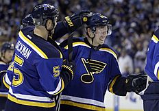 ������ � ������: St. Louis Blues' Barret Jackman, left, and Vladimir Tarasenko, of Russia, celebrate following Game 2 of an NHL hockey first-round playoff series against...