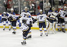 ������ � ������: St. Louis Blues right wing Dmitrij Jaskin (23), of Russia, and teammates stand on the ice after the Minnesota Wild defeated them 4-1 in Game 6 of an NHL...