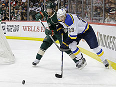 ������ � ������: St. Louis Blues right wing Dmitrij Jaskin (23), of Russia, and Minnesota Wild defenseman Jordan Leopold (33) chase the puck during the second period of...
