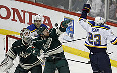 ������ � ������: Minnesota Wild defenseman Jordan Leopold (33) bobbles the puck next to St. Louis Blues right wing Dmitrij Jaskin (23), of Russia, as Blues center Patrik...
