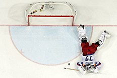 ������ � ������: Russia's goaltender Bobrovski lies on the ice after a goal from Canada during the Ice Hockey World Championship final game at the O2 arena in Prague