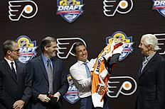������ � ������: Ivan Provorov, second from right, of Russia, puts on a Philadelphia Flyers sweater after being chosen seventh overall during the first round of the NHL...