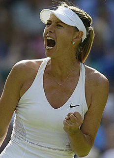 Maria Sharapova of Russia celebrates winning a point against Johanna Konta of Britain during the women's singles first round match at the All England Lawn...