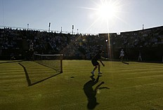 A ball boy throws tennis balls during the match between Ekaterina Makarova of Russia and Sachia Vickery of the U.S.A. at the Wimbledon Tennis Championships...