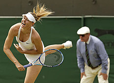 Maria Sharapova of Russia serves during her match against Richel Hogenkamp of the Netherlands at the Wimbledon Tennis Championships in London