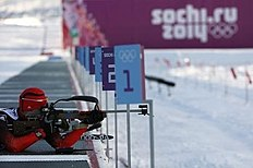 Loginov of Russia takes part in a biathlon training session for the 2014 Sochi Winter Olympic Games at the «Laura» cross-country and biathlon centre in...