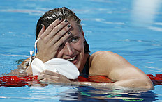 Hungary's gold medal winner Katinka Hosszu smiles after setting a new World Record in the women's 200m individual medley final at the Swimming World Championships...