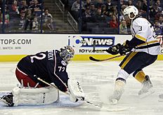 ������ � ������: Columbus Blue Jackets' Sergei Bobrovsky, left, of Russia, makes a save against Nashville Predators' Seth Jones during the third of an NHL preseason hockey...
