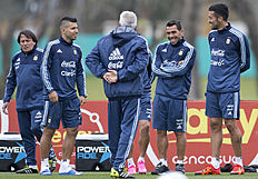 Argentina's Sergio Aguero, second left, Carlos Tevez, second right, and Ezequiel Garay, right, attend a training session in Buenos Aires, Argentina, Monday,...