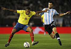 Argentina's Javier Pastore, right, fights for the ball with Ecuador's Antonio Valencia during a 2018 Russia World Cup qualifying soccer match in Buenos...
