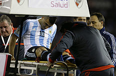 Argentina's Sergio Aguero is carried off the filed after an injury during a 2018 Russia World Cup qualifying soccer match against Ecuador, in Buenos Aires,...