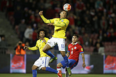 Brazil's Marquinhos, center, heads the ball while his teammate Marcelo, left, and Chile's Eduardo Vargas, observe during a 2018 Russia World Cup qualifying...
