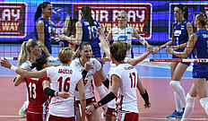 Poland's players celebrate during the Women's European Olympic Qualification match Poland vs Russia, on January 4, 2016 in Ankara. / AFP / ADEM ALTAN