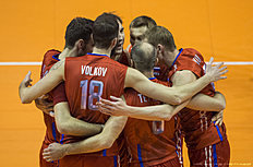 Russian players celebrate a point during the pool B match Finland vs Russia of the 2016 Men's Volleyball Olympic Qualification tournament in Berlin January 5, 2016. Russia won 3 to 0. / AFP / John MACDOUGALL