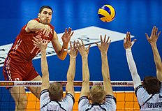 TOPSHOT — Russia's Kostyantin Bakun spikes the ball during the pool B match Finland vs Russia of the 2016 Men's Volleyball Olympic Qualification tournament in Berlin January 5, 2016. / AFP / John MACDOUGALL