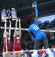 Russia Evgeniya Startseva (L) and Irina Fetisova (C) vie with Italy Paola Ogechi Egonu (R) during the Women's European Olympic Qualification volleyball match on January 5, 2016 in Ankara. / AFP / ADEM ALTAN