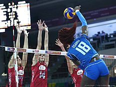 Russia Natalia Malykh(L) and Irina Fetisova (C) vie with Italy Paola Ogechi Egonu (R) during the Women's European Olympic Qualification volleyball match on January 5, 2016 in Ankara. / AFP / ADEM ALTAN