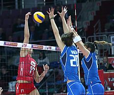 Russia Natalia Malykh(L) vies with Italy Anna Danes(C) during the Women's European Olympic Qualification volleyball match on January 5, 2016 in Ankara. / AFP / ADEM ALTAN