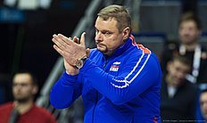 Russian coach Vladimir Alekno reacts during the pool B match Russia vs France of the 2016 Men's Volleyball Olympic Qualification tournament in Berlin January 6, 2016. / AFP / John MACDOUGALL