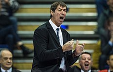 France's coach Laurent Tillie reacts during the pool B match Russia vs France of the 2016 Men's Volleyball Olympic Qualification tournament in Berlin January 6, 2016. / AFP / John MACDOUGALL