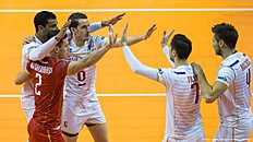 France's players celebrate a point during the pool B match Russia vs France of the 2016 Men's Volleyball Olympic Qualification tournament in Berlin January 6, 2016. / AFP / John MACDOUGALL