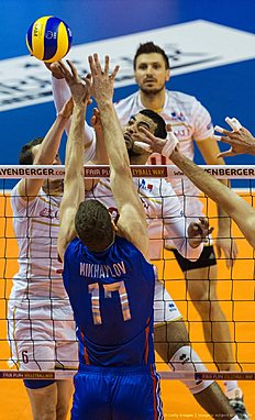 France's Earving Ngapeth reaches for the ball during the pool B match Russia vs France of the 2016 Men's Volleyball Olympic Qualification tournament in Berlin January 6, 2016. / AFP / John MACDOUGALL