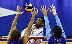 France's Earving Ngapeth spikes the ball during the pool B match Russia vs France of the 2016 Men's Volleyball Olympic Qualification tournament in Berlin January 6, 2016. / AFP / John MACDOUGALL