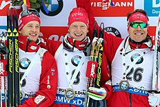 Winner Johannes Thingnes Boe , center, his second placed brother Tarjei Boe left, and third placed Emil Hegle Svendsen, all from Norway celebrate after the men's 10 km sprint race at the Biathlon World Cup in Ruhpolding, Germany, Friday Jan. 8, 2016. ( Karl-Josef Hildenbrand/dpa via AP)
