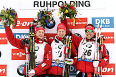 RUHPOLDING, GERMANY — JANUARY 8: (FRANCE OUT) Johannes Thingnes Boe of Norway takes 1st place, Tarjei Boe of Norway takes 2nd place, Emil Hegle Svendsen of Norway takes 3rd place during the IBU Biathlon World Cup Men's and Women's Sprint on January 8, 2016 in Ruhpolding, Germany.