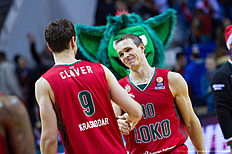 KRASNODAR, RUSSIA — JANUARY 08: Victor Claver, #9 of Lokomotiv Kuban Krasnodar and Sergey Bykov, #10 of Lokomotiv Kuban Krasnodar after the Turkish Airlines Euroleague Basketball Top 16 Round 2 game between Lokomotiv Kuban Krasnodar v Anadolu Efes Istanbul at Basket Hall on January 8, 2016 in Krasnodar, Russia.
