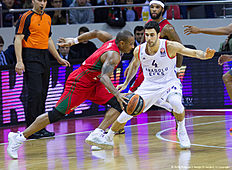 KRASNODAR, RUSSIA — JANUARY 08: Dontaye Draper, #4 of Lokomotiv Kuban Krasnodar competes with Dogus Balbay, #4 of Anadolu Efes Istanbul during the Turkish Airlines Euroleague Basketball Top 16 Round 2 game between Lokomotiv Kuban Krasnodar v Anadolu Efes Istanbul at Basket Hall on January 8, 2016 in Krasnodar, Russia.