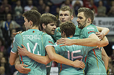 Germany's players celebrate a point during the pool A match Poland vs Germany of the 2016 Men's Volleyball Olympic Qualification tournament in Berlin on January 8, 2016. Germany won 3 to 2 and will face Russia in the semi-finals. / AFP / John MACDOUGALL