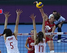Tatiana Kosoleva (R) of Russia smashes the ball in front of Kubra Akman (L) N. Demirgu00fcler (C) of Turkey during the CEV volleyball women's 2016 European Olympic Qualification semi final match between Russia and Turkey in Ankara on January 8, 2016. / AFP / ADEM ALTAN