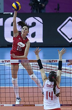 Tatiana Kosoleva (L) of Russia smashes the ball in front of Eda Du00fcndar (bottom) of Turkey during the CEV volleyball women's 2016 European Olympic Qualification semi final match between Russia and Turkey in Ankara on January 8, 2016. / AFP / ADEM ALTAN