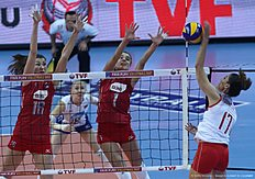 Yana Shcherban (C) and Ir?na Zaryazhko (L) of Russia vies with Demirguler (R) of Turkey during the CEV volleyball women's 2016 European Olympic Qualification semi final match between Russia and Turkey in Ankara on January 8, 2016. / AFP / ADEM ALTAN