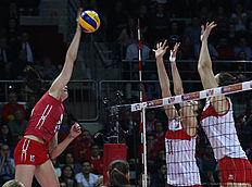 Tatiana Kosoleva (L) of Russia smashes the ball in front of Naz Akyol (R) of Turkey during the CEV volleyball women's 2016 European Olympic Qualification semi final match between Russia and Turkey in Ankara on January 8, 2016. / AFP / ADEM ALTAN