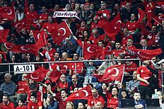 Turkish fans cheer their team during the CEV volleyball women's 2016 European Olympic Qualification semi final match between Russia and Turkey in Ankara on January 8, 2016. / AFP / ADEM ALTAN
