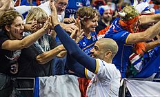France's Earvin Ngapeth celebrates with supporters after the semi-final match France vs Poland of the 2016 Men's Volleyball Olympic Qualification tournament in Berlin January 9, 2016. nFrance won 3 to 0, and face Russia in the final. / AFP / John MACDOUGALL