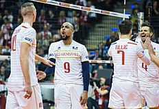 France's players, including Earvin Ngapeth (2nd from L) celebrate a point during the third set in the semi-final match France vs Poland of the 2016 Men's Volleyball Olympic Qualification tournament in Berlin January 9, 2016. nFrance won 3 to 0, and face Russia in the final.France won 3 to 0, and face Russia in the final. / AFP / John MACDOUGALL