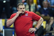 Russia's coach Vladimir Alekno bites his nails during the semi-final match Germany vs Russia of the 2016 Men's Volleyball Olympic Qualification tournament in Berlin January 9, 2016. / AFP / John MACDOUGALL