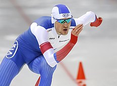 Denis Yuskov, of Russia, competes to win the men's 500m race at the «Minsk-Arena» Speed Skating Stadium during the European Speed Skating Championship, in Minsk, Belarus, on Saturday, Jan. 9, 2016. (AP Photo/Sergei Grits)