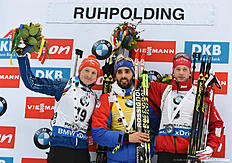 (L-R) Czech Ondrej Moravec, French Martin Fourcade and Norwegian Tarjei Boe pose during the winner ceremony of the men 15 kilometer mass start competition at the Biathlon World Cup on January 10, 2016 in Ruhpolding, southern Germany. nFrench Martin Fourcade won the competition, Czech Ondrej Moravec placed second and Norwegian Tarjei Boe placed third. / AFP / Christof STACHE