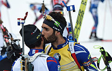 French Martin Fourcade (R) kisses his brother Simon Fourcade in the finish after the men 15 kilometer mass start competition at the Biathlon World Cup on January 10, 2016 in Ruhpolding, southern Germany.nFrench Martin Fourcade won the competition, Czech Ondrej Moravec placed second and Norwegian Tarjei Boe placed third. / AFP / Christof STACHE