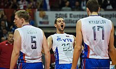 Russia's Alexander Markin celebrates a point during the final match France vs Russia of the 2016 Men's Volleyball Olympic Qualification tournament in Berlin January 10, 2016. nRussia defeated France 3 to 1, and earned an automatic qualification for the Rio Olympics. / AFP / John MACDOUGALL