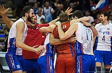Russia's player celebrate after the final match France vs Russia of the 2016 Men's Volleyball Olympic Qualification tournament in Berlin January 10, 2016. nRussia defeated France 3 to 1, and earned an automatic qualification for the Rio Olympics. / AFP / John MACDOUGALL