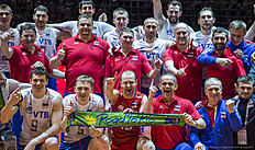Members of the Russian volleybal team pose with a«Road to Rio»scarf after Russia defeated France in the final match France vs Russia of the 2016 Men's Volleyball Olympic Qualification tournament in Berlin January 10, 2016.nThe Russians earned an automatic qualification for the Rio Olympics. / AFP / John MACDOUGALL